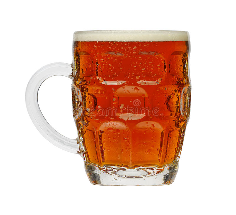 Traditional Pint of Beer. In a typical British dimple glass royalty free stock photography