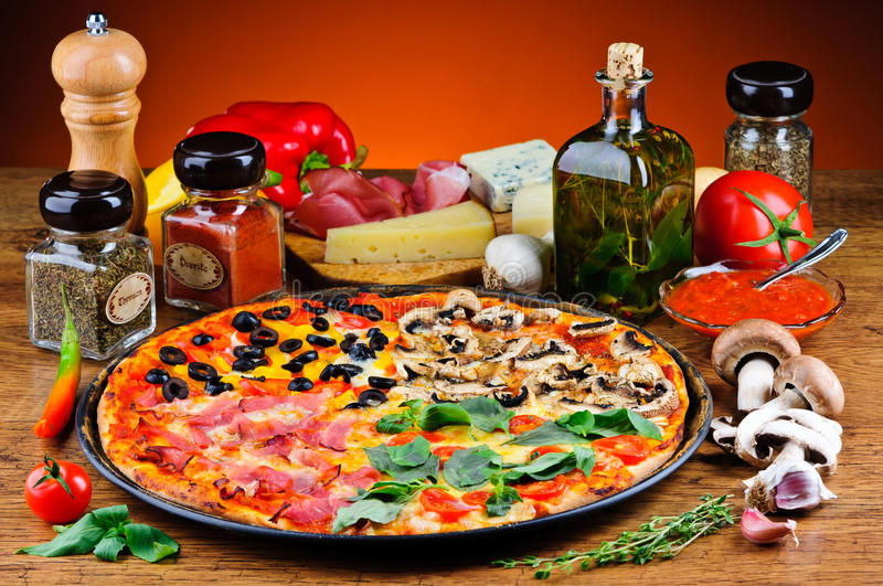 Traditional pizza and ingredients royalty free stock photo