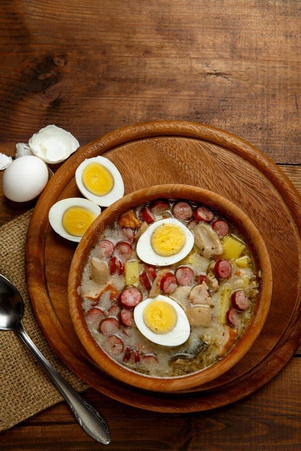 Traditional polish Easter soup Zurek. Traditional Zurek with sausage and egg, white borscht, polish homemade Easter soup stock images