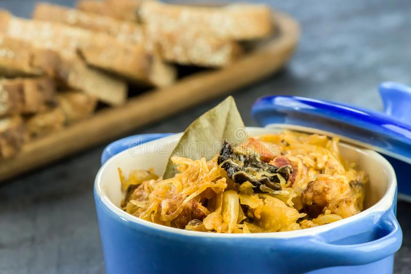 Traditional Polish food - bigos. Bigos - traditional Polish Easter and Christmas dish - closeup in blue bowl royalty free stock photo