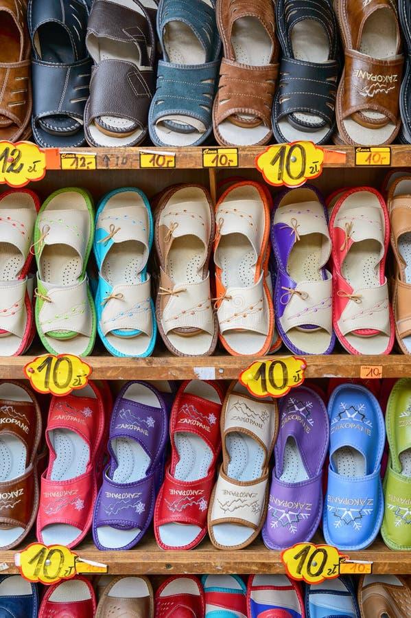 Traditional polish leather slipper on street market in Zakopane, Poland. 5 JULY 2016 ZAKOPANE, POLAND . Traditional polish leather slipper on street market in stock photos