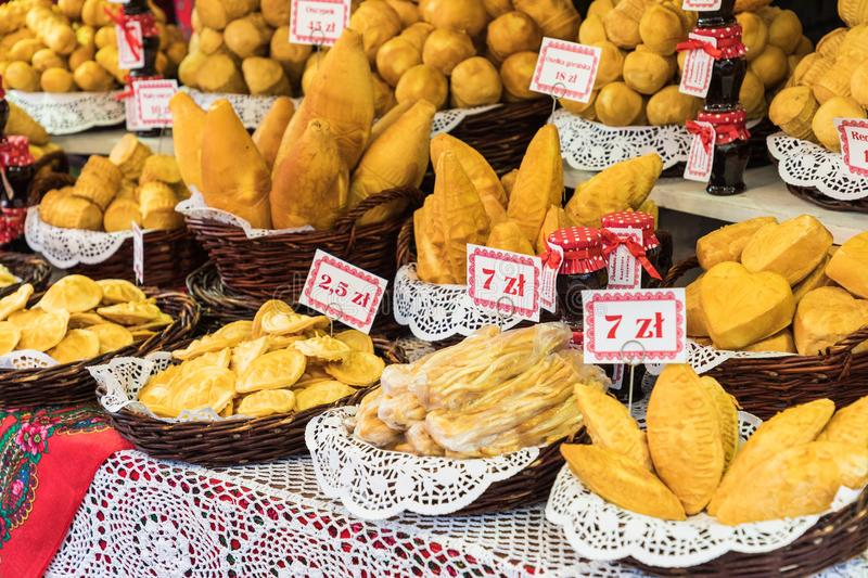 Traditional polish smoked cheese oscypek on Christmas market in stock photography