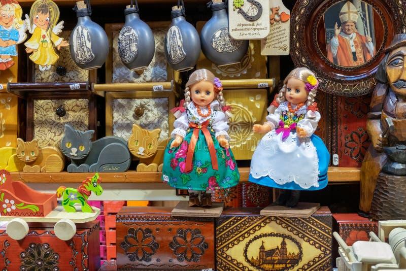 Traditional Polish souvenir dolls at gift store. Christmas market in Krakow, Poland. KRAKOW, POLAND - DECEMBER 10, 2019: Traditional Polish souvenir dolls at royalty free stock image
