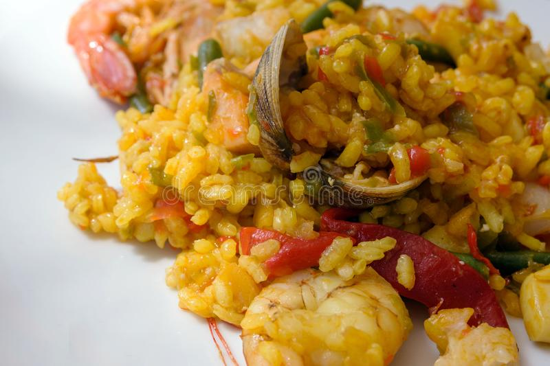 A traditional popular Spanish seafood paella dish. Mussels, Amandi and prawns on a pillow of rice. stock images