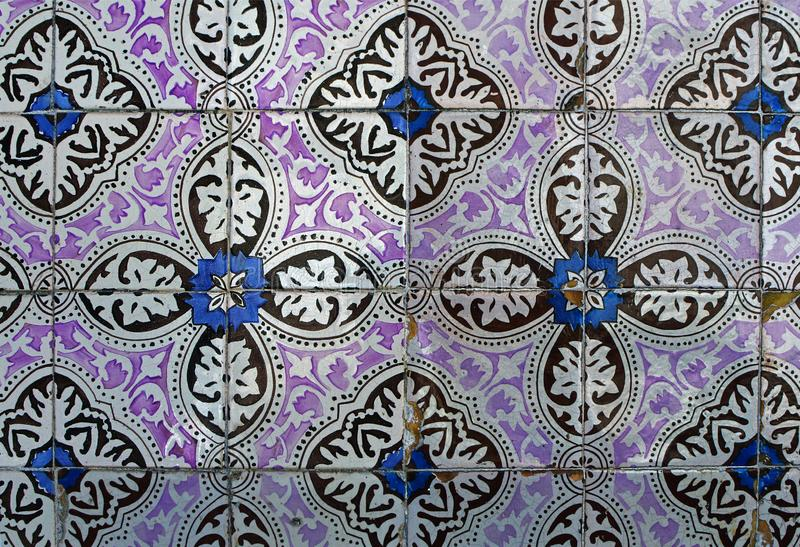 Traditional porcelain ceramic tile azulejo on the facade of the. House  77-81 rua das Taipas in Lisbon, Portugal royalty free stock photography