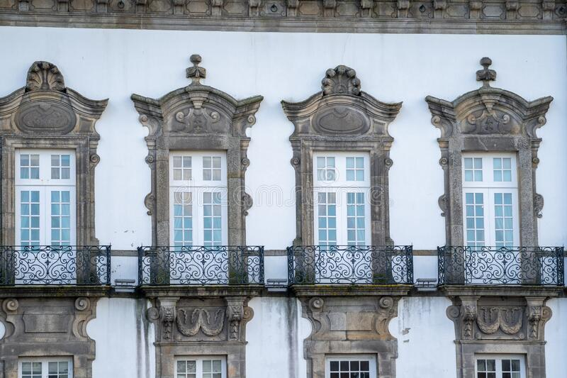 Traditional Porto Portugal building exterior with windows and ornate balconies with a white facade stock photos