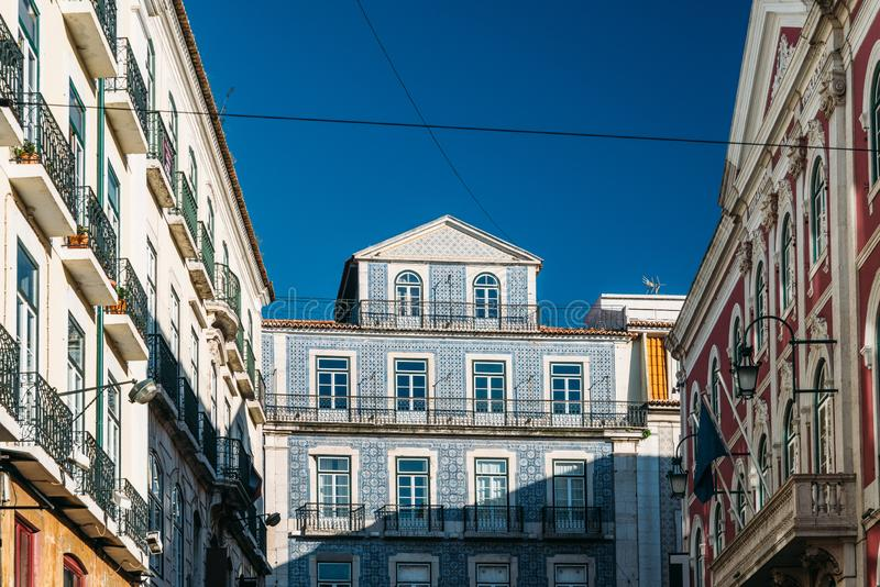 Traditional Portugal house facade with doors, windows and balcony. Blue azulejos tiled building wall in Lisbon.  stock images