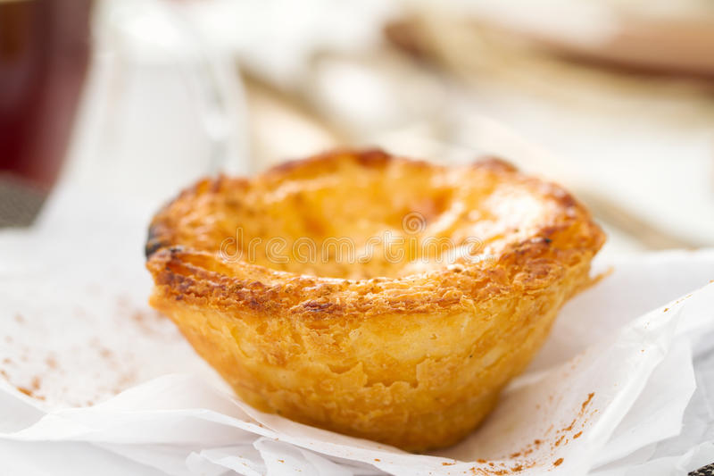 Traditional portuguese dessert pastel de nata. With cup of coffee stock photo