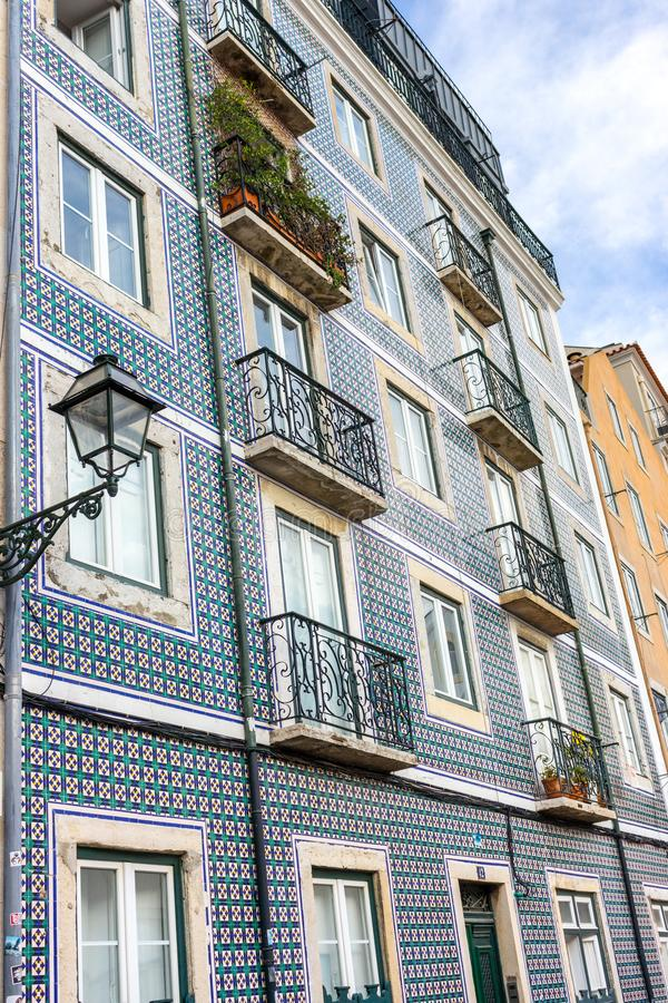Traditional portuguese facade decoration azulejos. Blue and white azulejo tiles. Azulejo exterior with balconies and lantern in Lisbon, Portugal. Ceramic royalty free stock photos