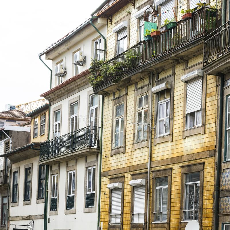 Traditional Portuguese facade. Sometimes decorated with ceramic tiles of azulejo in the historical centre of the city of Porto stock image