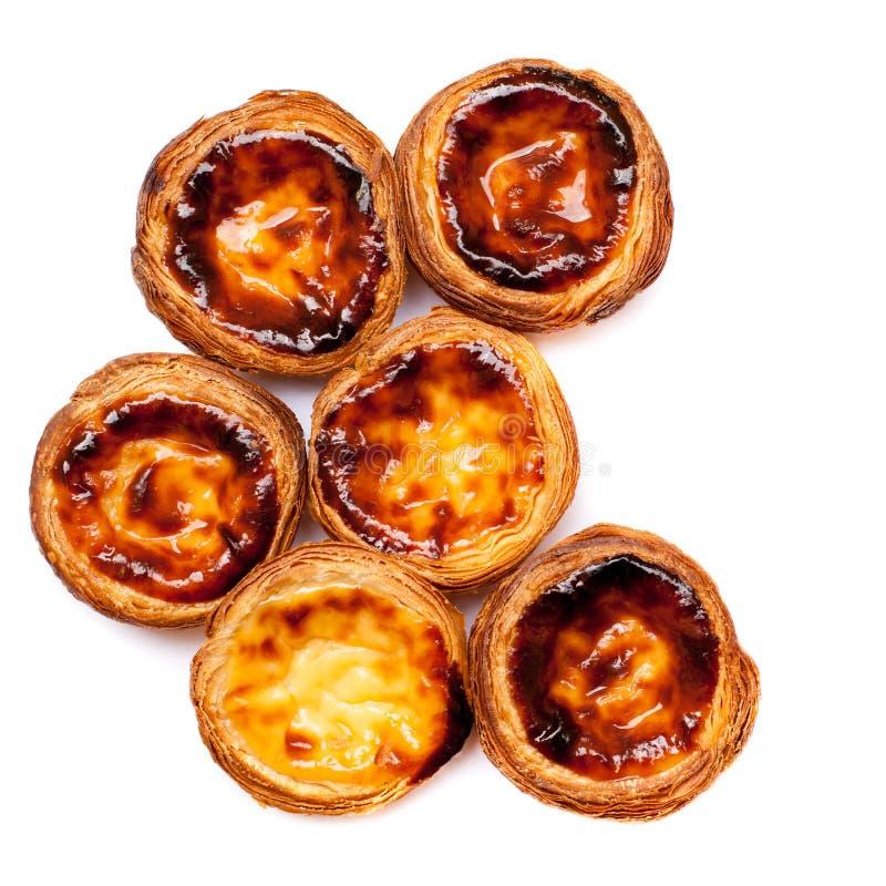 Traditional portuguese specialty tart name Nata on whit stock photos