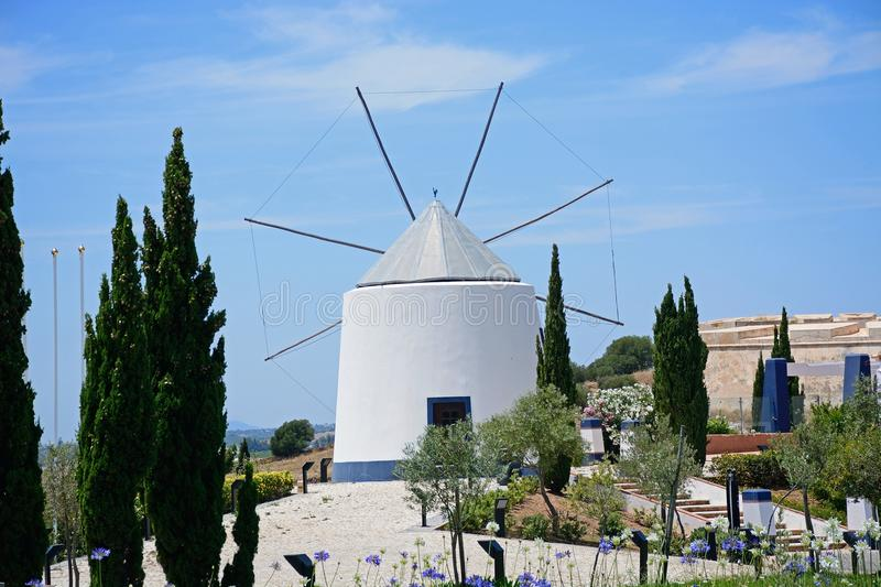 Traditional Portuguese windmill, Castro Marim. Traditional whitewashed windmill at the top of the hill, Castro Marim, Algarve, Portugal, Europe stock photos