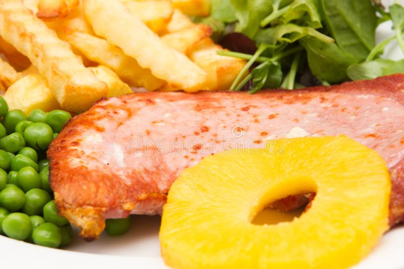 Gammon steak with a pineapple ring royalty free stock photo