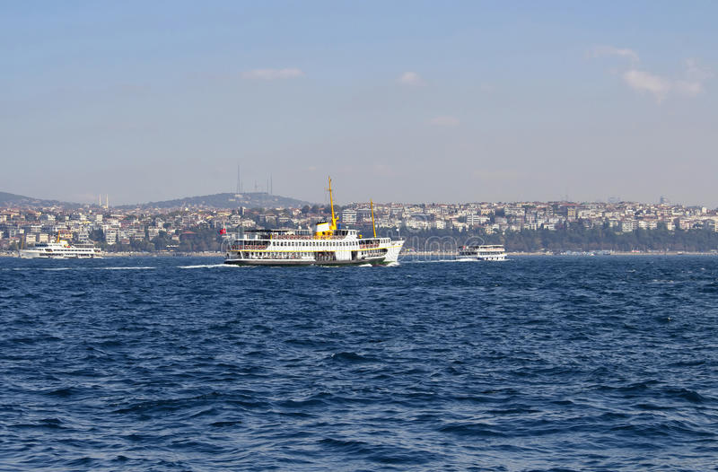 Traditional public ferry crosses Bosphorus from European. To Asian side. It`s a sunny summer day in Istanbul royalty free stock image