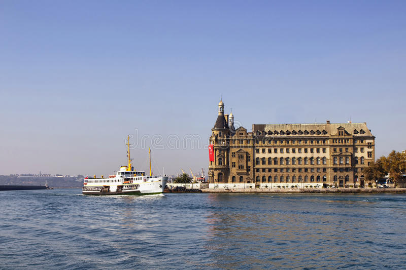Traditional public ferry passes. By historical train terminal named Haydarpasa. Until 2012 the station was a major intercity, regional and commuter rail hub in stock photos
