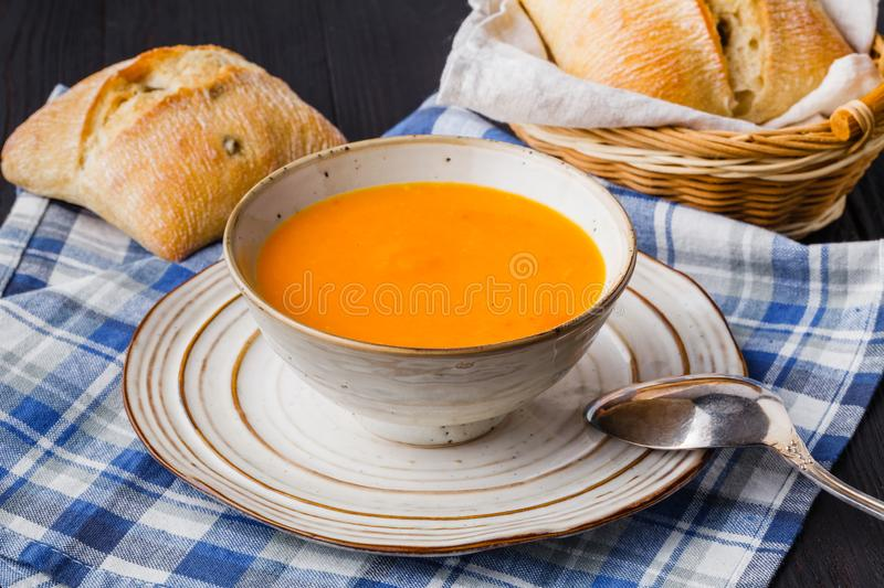 Traditional pumpkin soup, homemade with bread royalty free stock photo