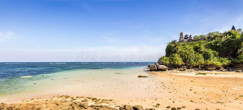 Pura temple on Geger beach on Bali island royalty free stock image