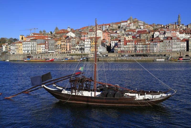 Traditional rabelo boats, Porto city skyline, Douro river and and Dom Luis or Luiz iron bridge. Porto stock photography