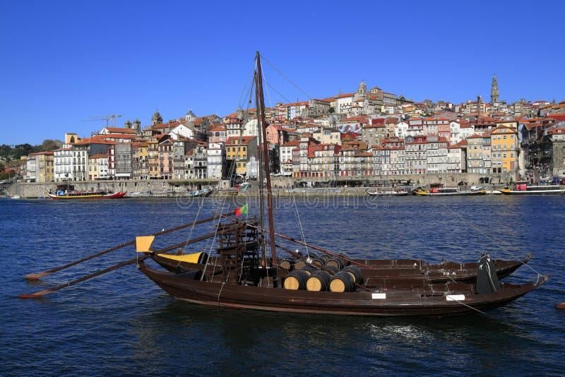 Traditional rabelo boats, Porto city skyline, Douro river and and Dom Luis or Luiz iron bridge. Porto stock images