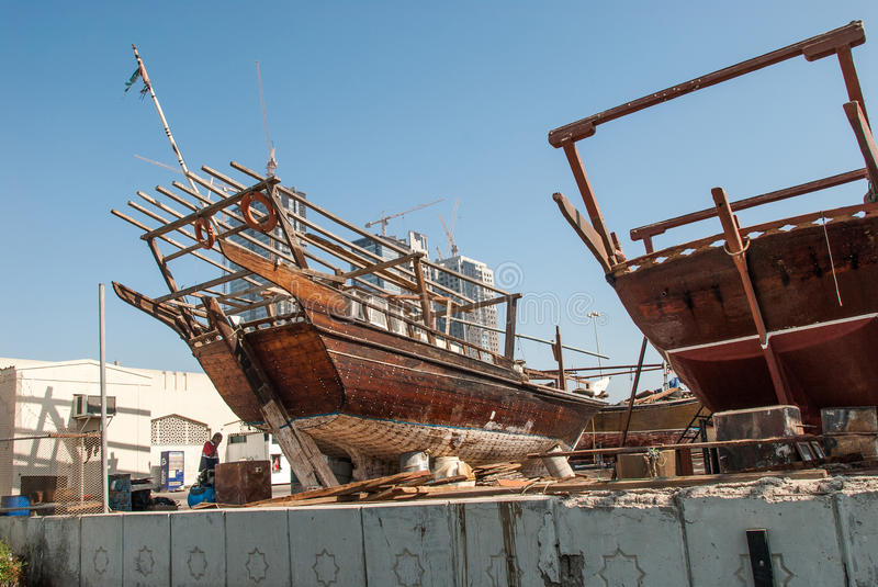 Traditional RAcing Dhows in Abu Dhabi. Racing dhows in the harbour dry dock for maintenance at Abu Dhabi, UAE stock image