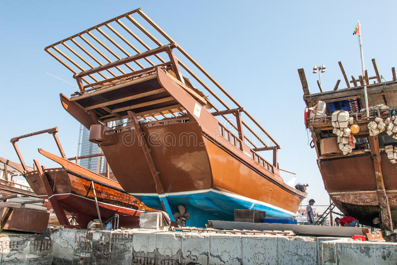Traditional Racing Dhows in Abu Dhabi. Racing dhows in the harbour dry dock for maintenance at Abu Dhabi, UAE stock photos