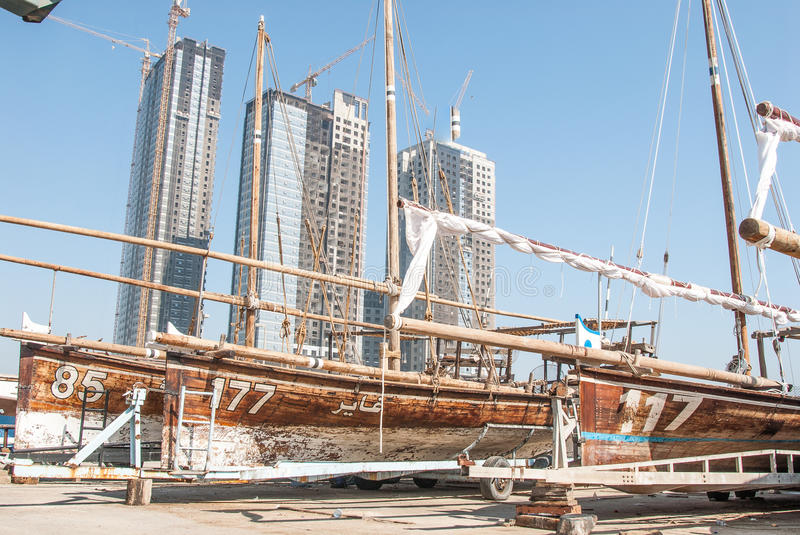 Traditional Racing Dhows in Abu Dhabi. Racing dhows in the harbour dry dock for maintenance at Abu Dhabi, UAE royalty free stock images