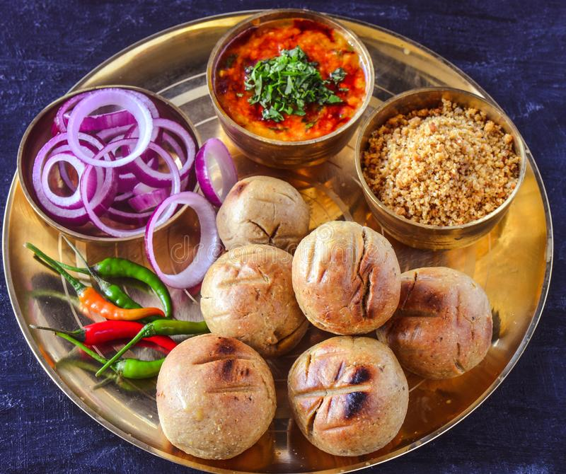 Indian meal-Dal baati churma served in traditional brass plate. Traditional Rajasthani meal dal bati churma is a meal fit for kings.In brass plate, following royalty free stock photography