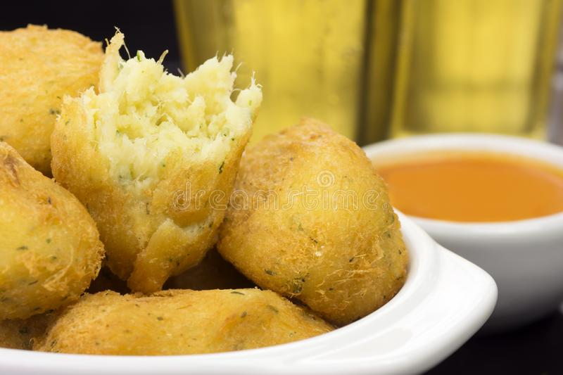 Traditional recipe codfish balls in a pub table with one open in close royalty free stock images