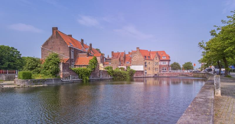 Traditional red brick house and canal in Bruges, Belgium royalty free stock image