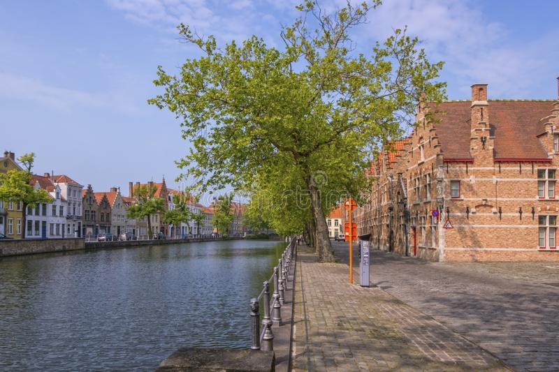 Traditional red brick house and canal in Bruges, Belgium stock photos