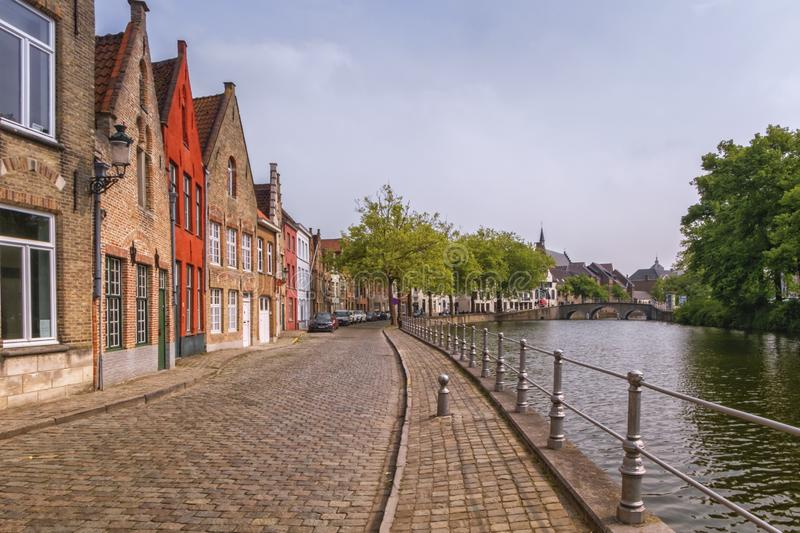 Traditional red brick houses and canal in Bruges, Belgium royalty free stock image