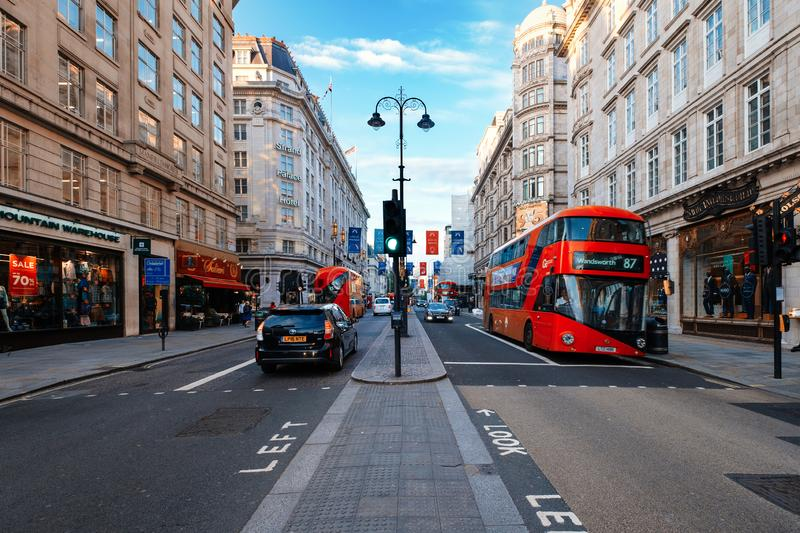 Traditional red bus at The Strand, a historic avenue in central London stock image