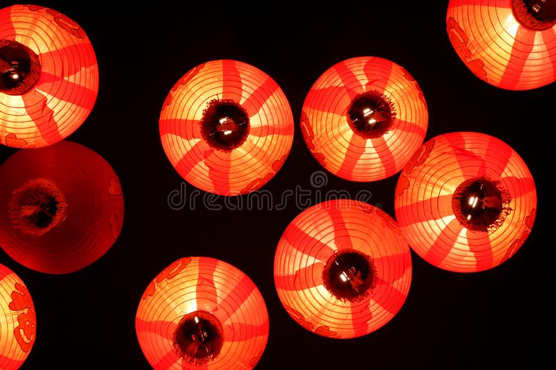Traditional red Christmas chinese lanterns on black ceiling background stock image