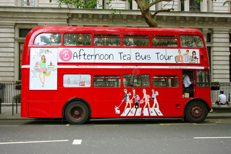 The traditional red double-decker London buses in the traffic on the streets of Soho.  royalty free stock photography