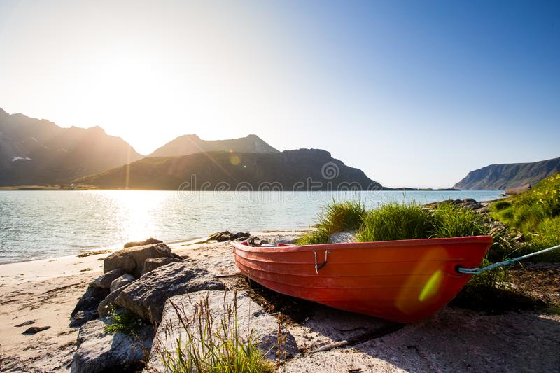 Red Fishing Boat On The Shores Of Lofoten royalty free stock photos