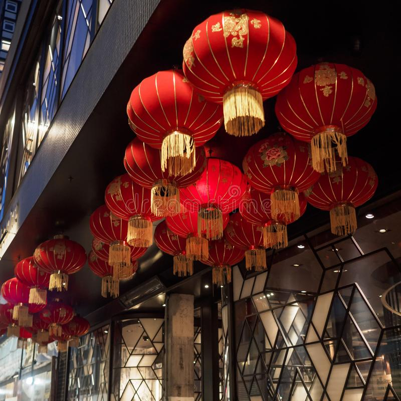 Traditional red lanterns outside a Chinese restaurant in Soho London. Squared format royalty free stock photography