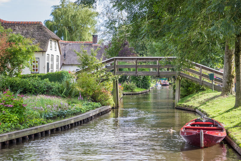 Traditional red punter boat in the canals of Giethoorn. Netherlands stock photography