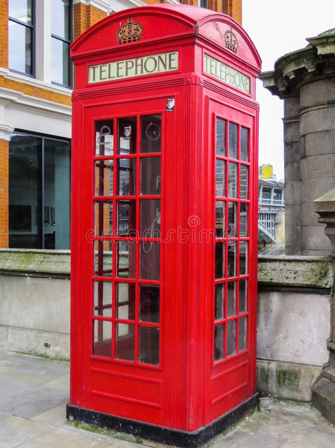Traditional red telephone box on street in London.United Kingdom, 03 June 2018 royalty free stock photos