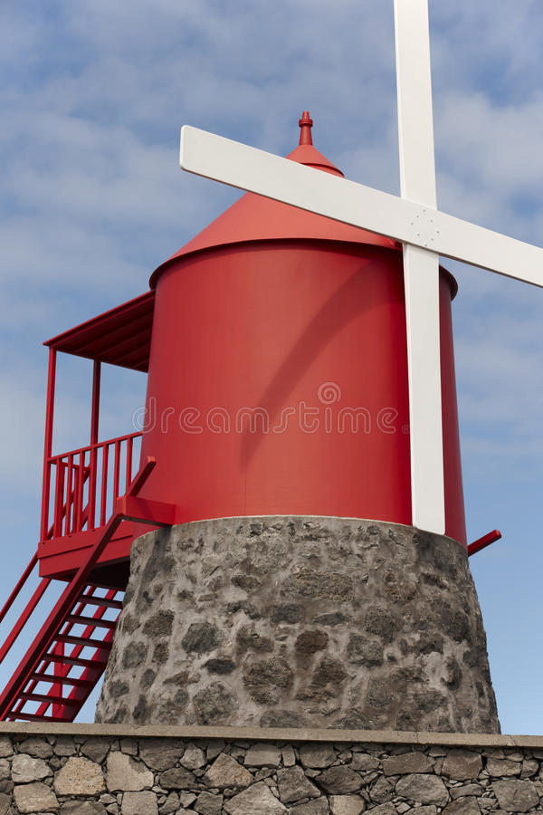 Traditional red and white windmill in Pico island, Azores. Portu. Gal. Vertical royalty free stock photography