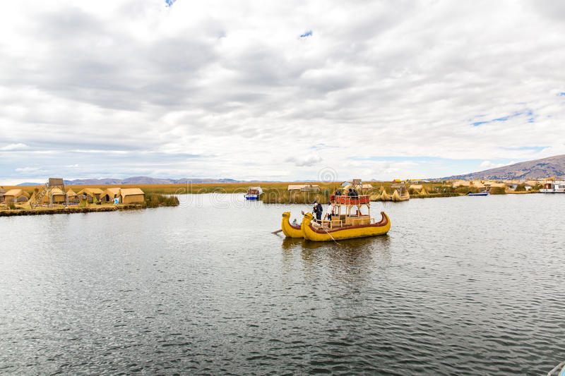 Traditional reed boat lake Titicaca,Peru,Puno,Uros,South America,Floating Islands,natural layer. About one to two meters thick that support islands stock photos