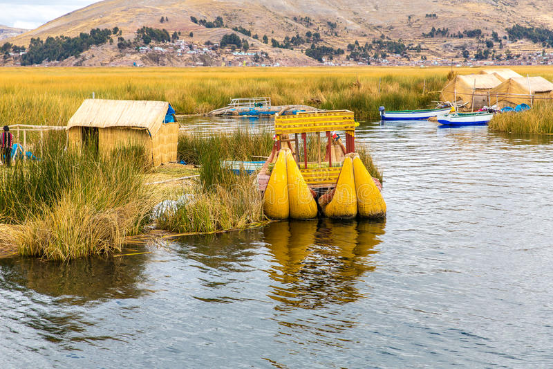 Traditional reed boat lake Titicaca,Peru,Puno,Uros,South America,Floating Islands,natural layer. About one to two meters thick that support islands stock images