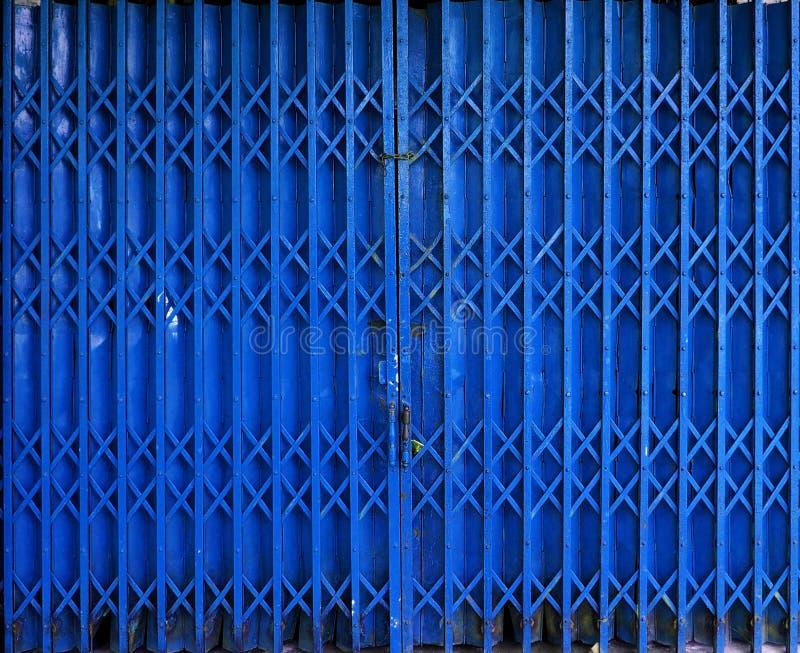Retractable Folding Blue Door Gate Stock Image - Image of metallic ...