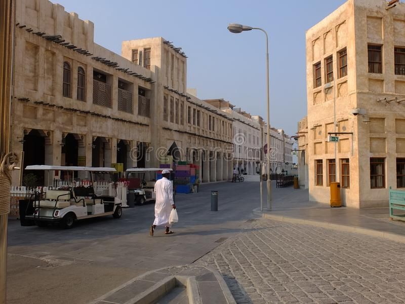 Traditional road and buildings in Doha Qatar. Souq street in Souq Waqif neighborhood, restored historical area with perfect examples of authentic residential and royalty free stock photo