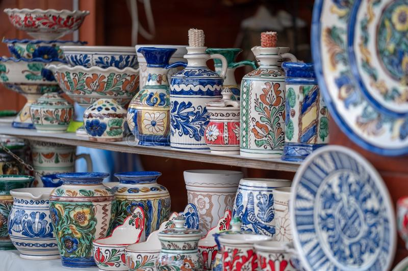 Traditional Romanian ceramics. Traditional Romanian handmade ceramics for sale in a village shop royalty free stock photos