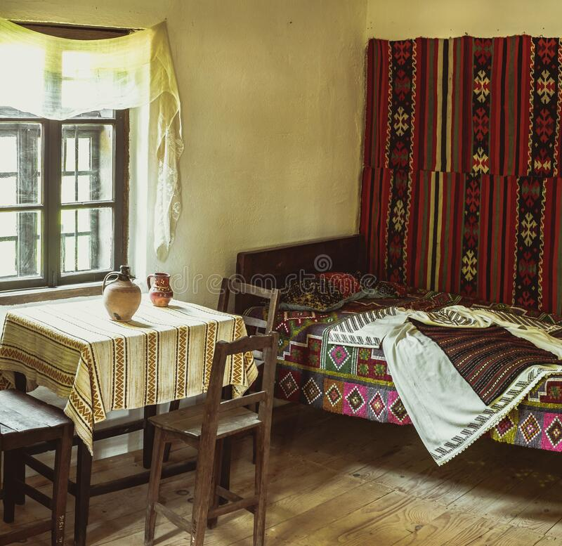 Traditional Romanian folk house interior with rural decoration stock photography