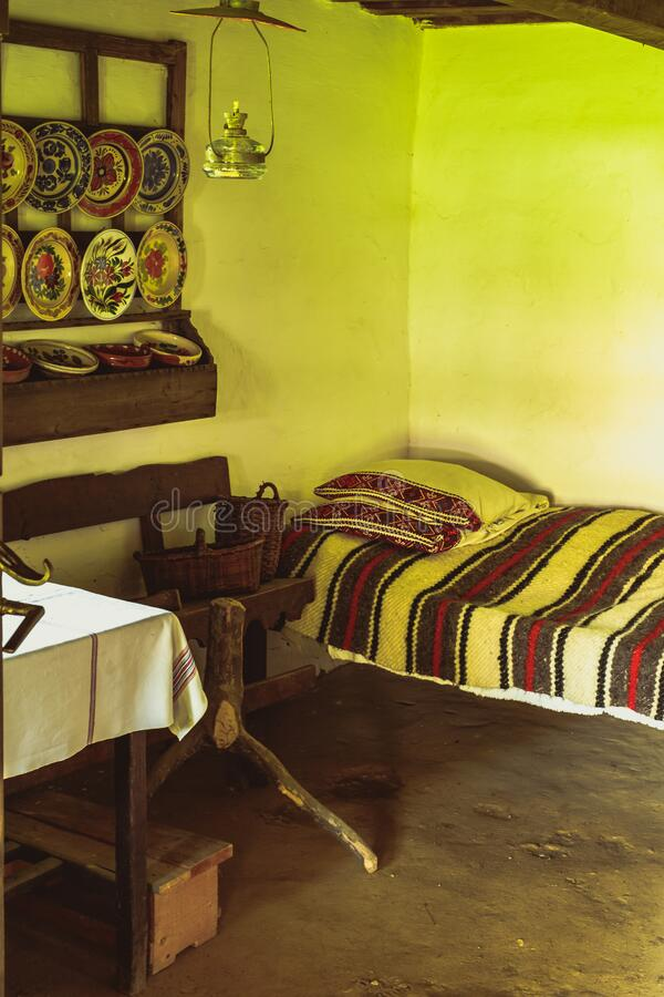 Traditional Romanian folk house interior with rural decoration royalty free stock photography
