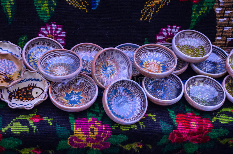 Traditional Romanian hand-painted. Ceramic plates used for serving food are popular tourist souvenirs stock photo