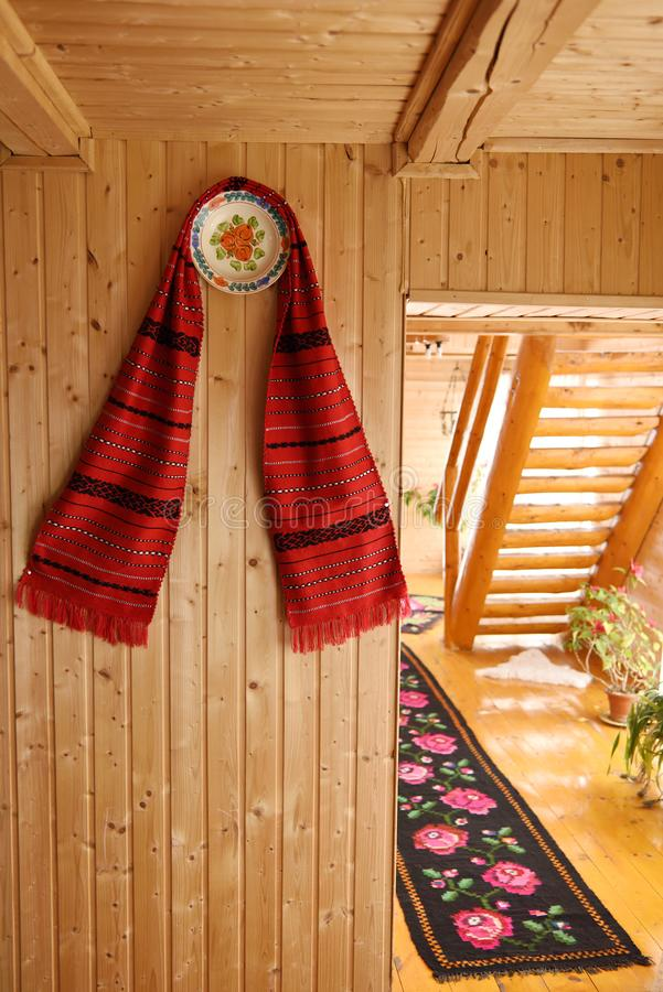 Traditional romanian towel and painted plates from Maramures, Romania. Traditional romanian towel and painted plates hanging on the wooden wall of traditional royalty free stock photography