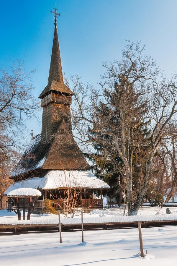 Traditional Romanian wooden Church covered in snow stock photos