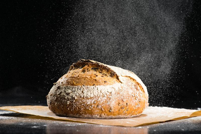Traditional round artisan rye bread loaf with walnut and seeds w stock photos
